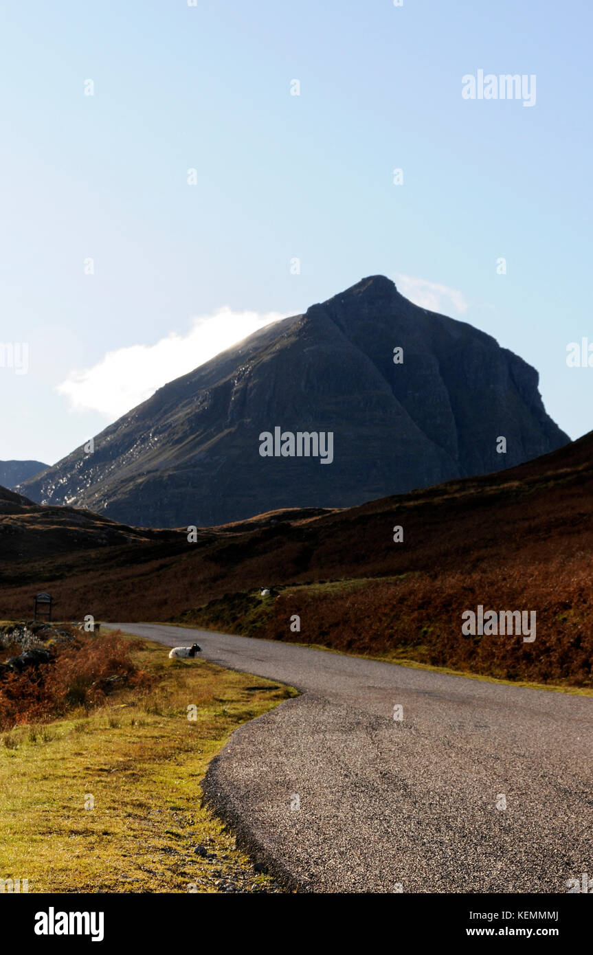 Quinag mountain scene from the A 894 road that winds it's way north to kylesku, the next hamlet and to Durness - Stock Image