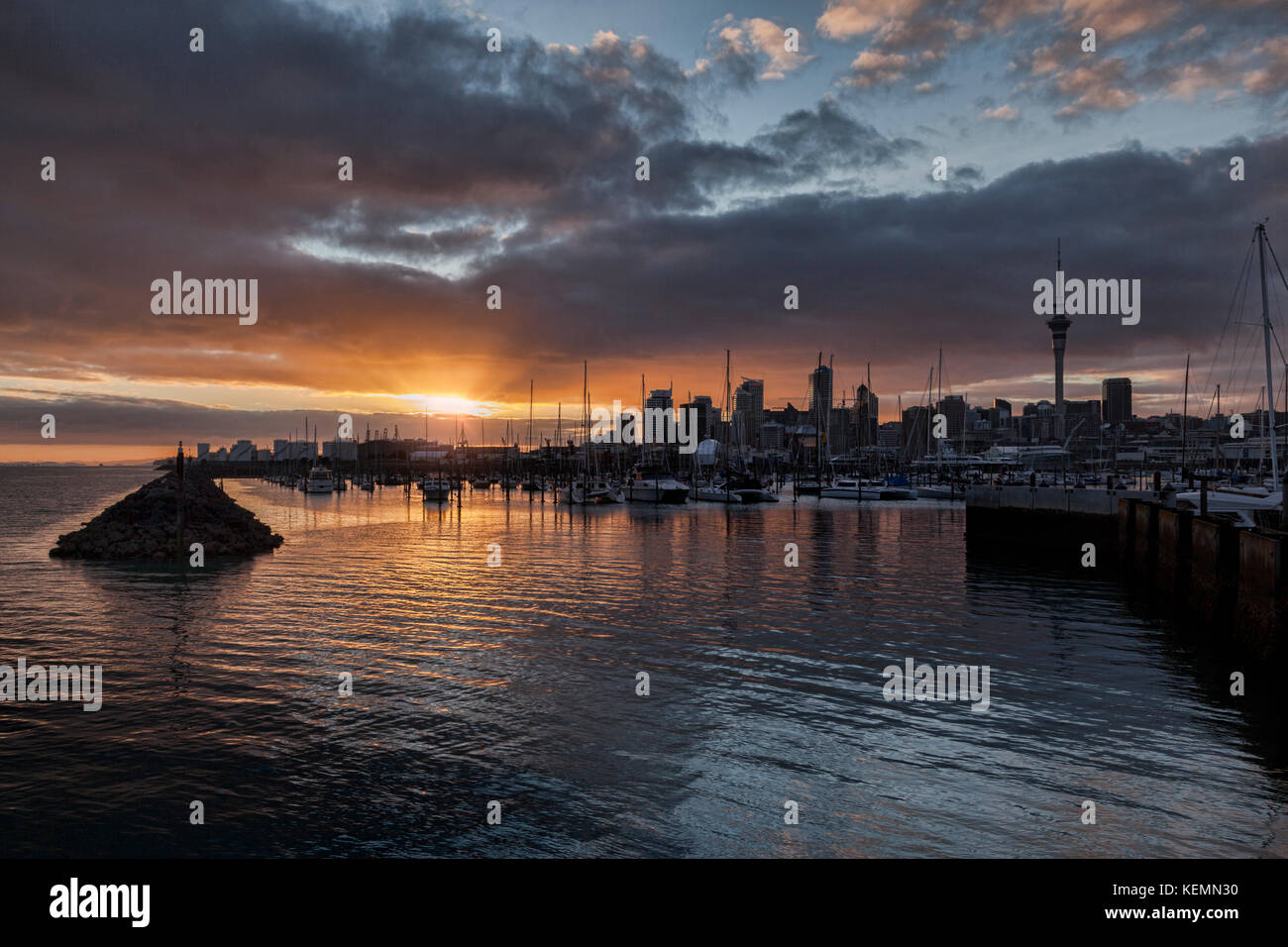 Sunrise over the city of Auckland and Westhaven Marina, New Zealand. Stock Photo