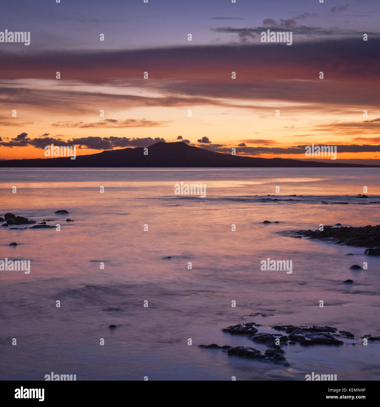 Rangitoto Island, a dormant volcano off Auckland, New Zealand, before sunrise. - Stock Image