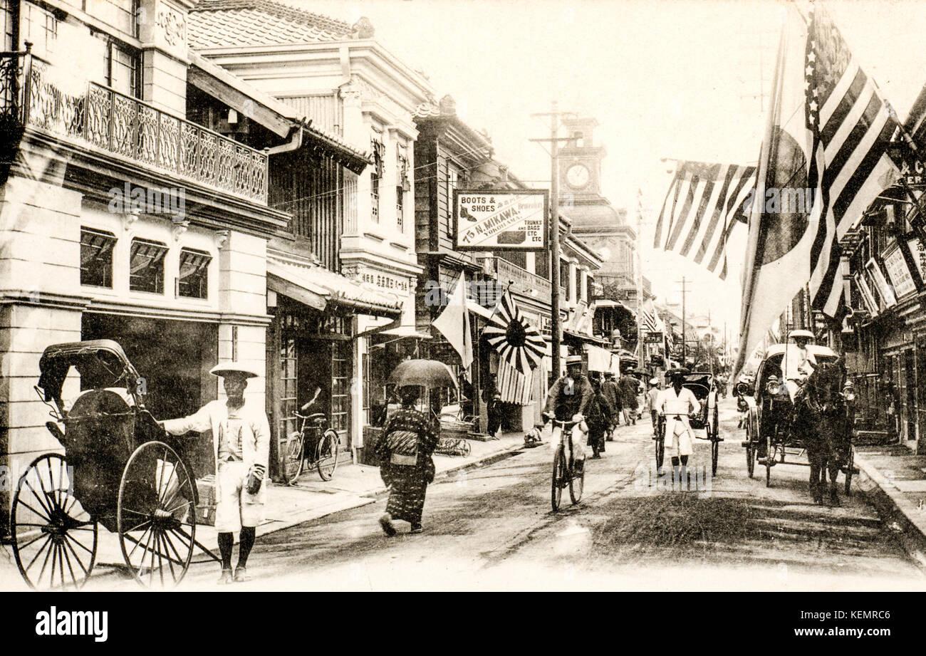 Japan, Yokohama. Vintage, circa 1900, black and white postcard of busy street scene in Japanese town. Benten-dori, - Stock Image