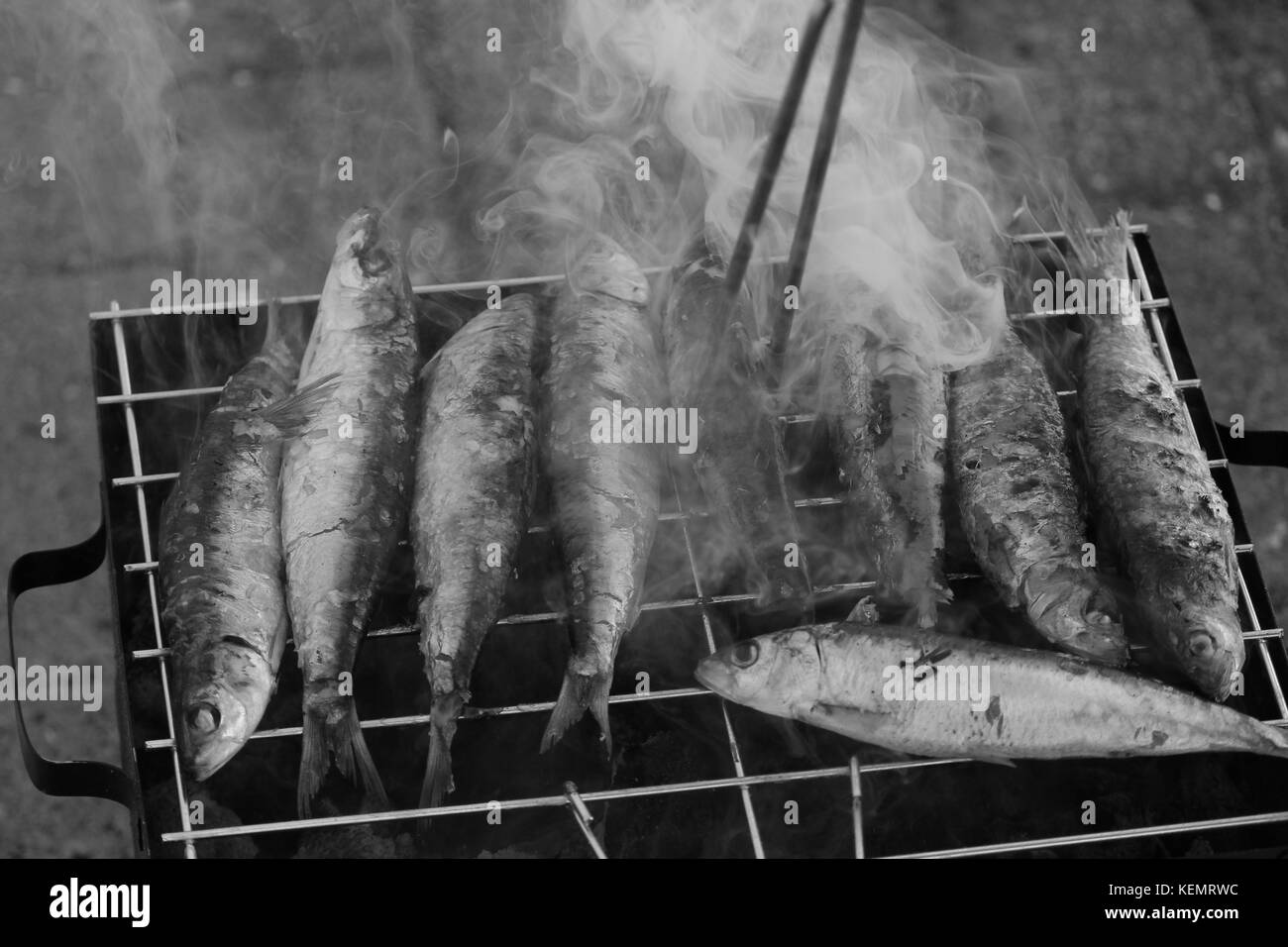 Freshly grilled sardines on the grill - Stock Image