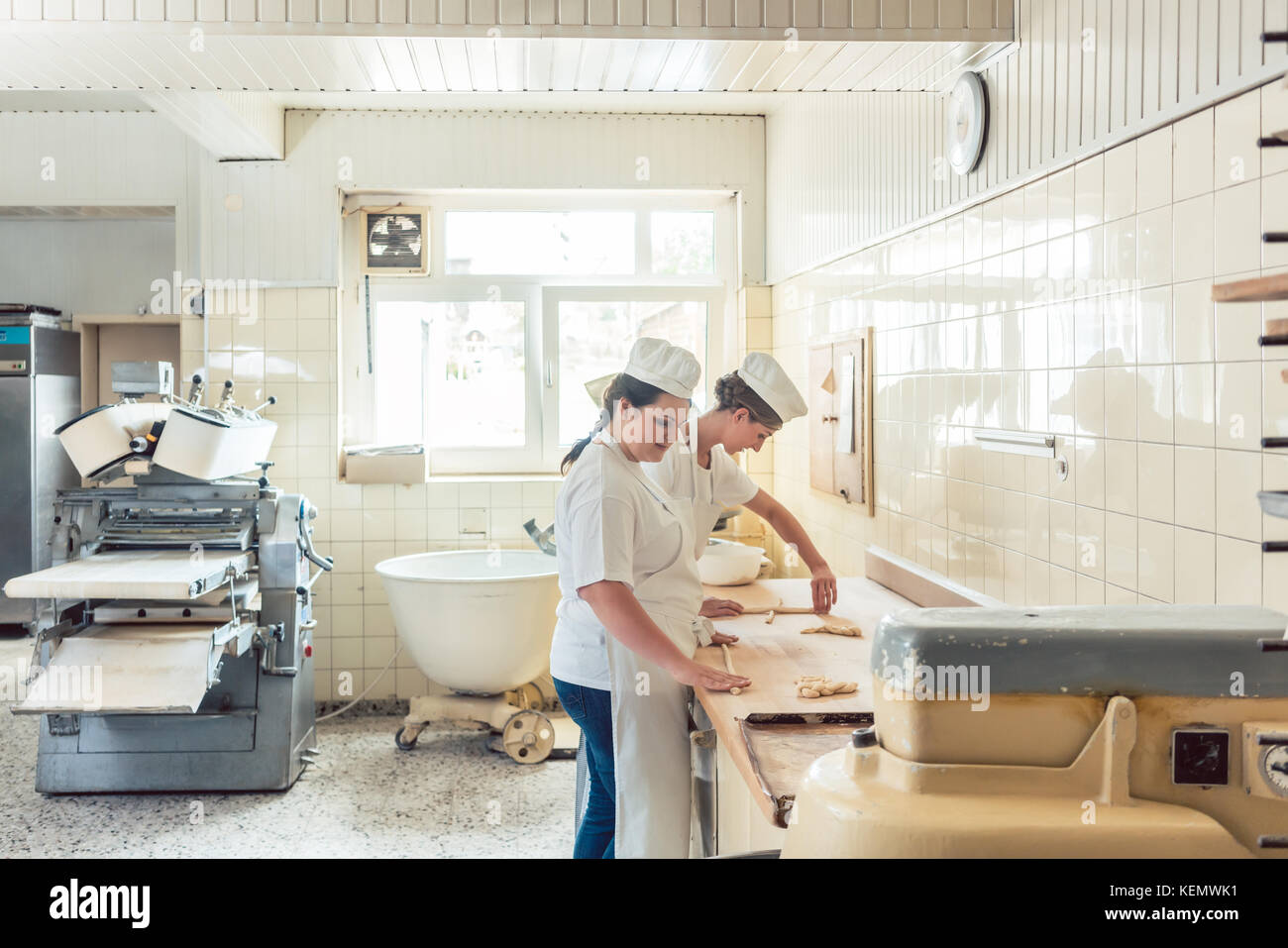 Wide view of bread production in bakery - Stock Image