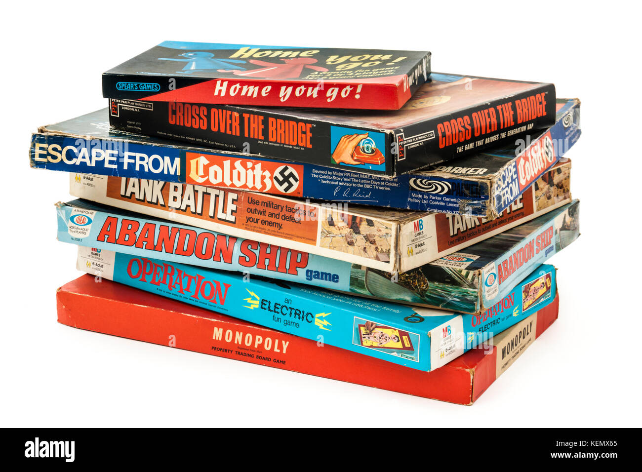 Collection of vintage board games, including Monopoly, Operation, Abandon Ship, Tank Battle, Escape from Colditz - Stock Image