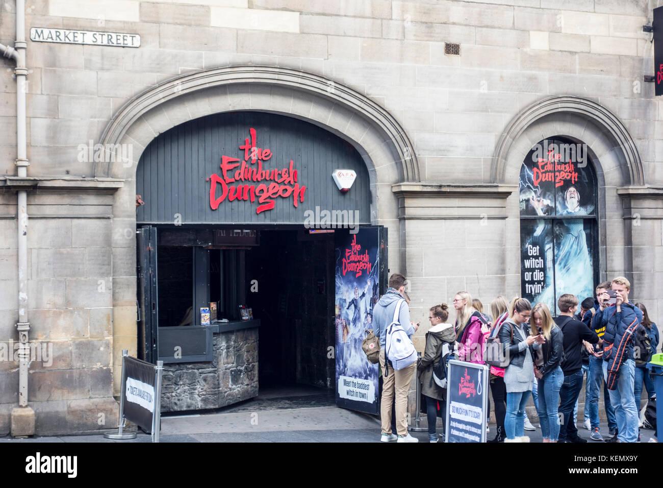 People in a queue outside The Edinburgh Dungeon, Market Street, Edinburgh, Scotland, UK - Stock Image