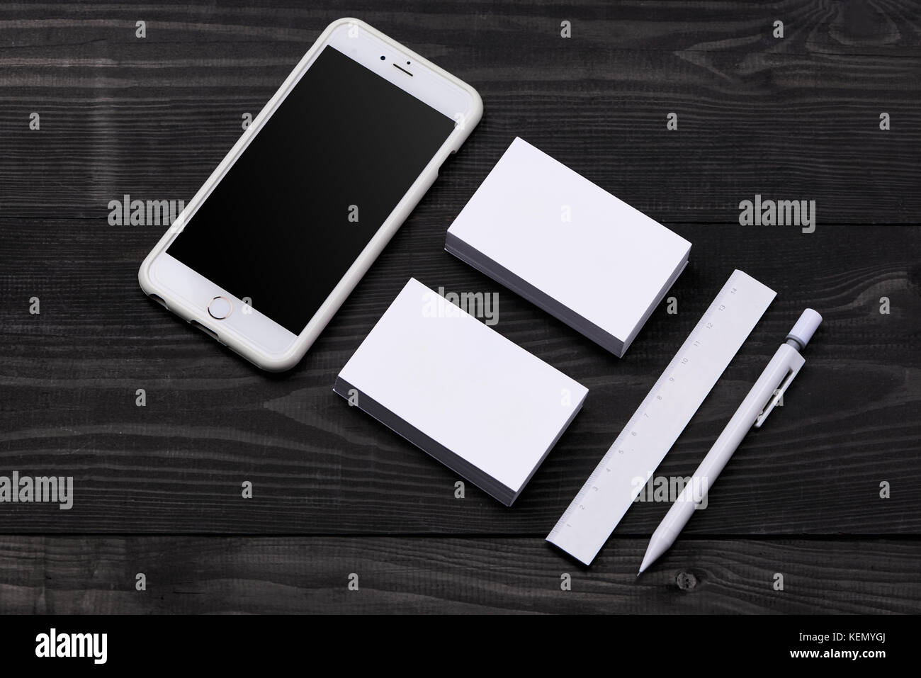 Mockup of cellphone with blank screen and business cards stock photo mockup of cellphone with blank screen and business cards colourmoves