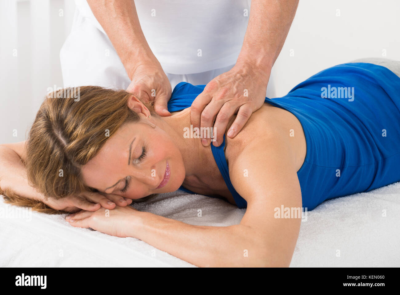 Giving massage mature woman