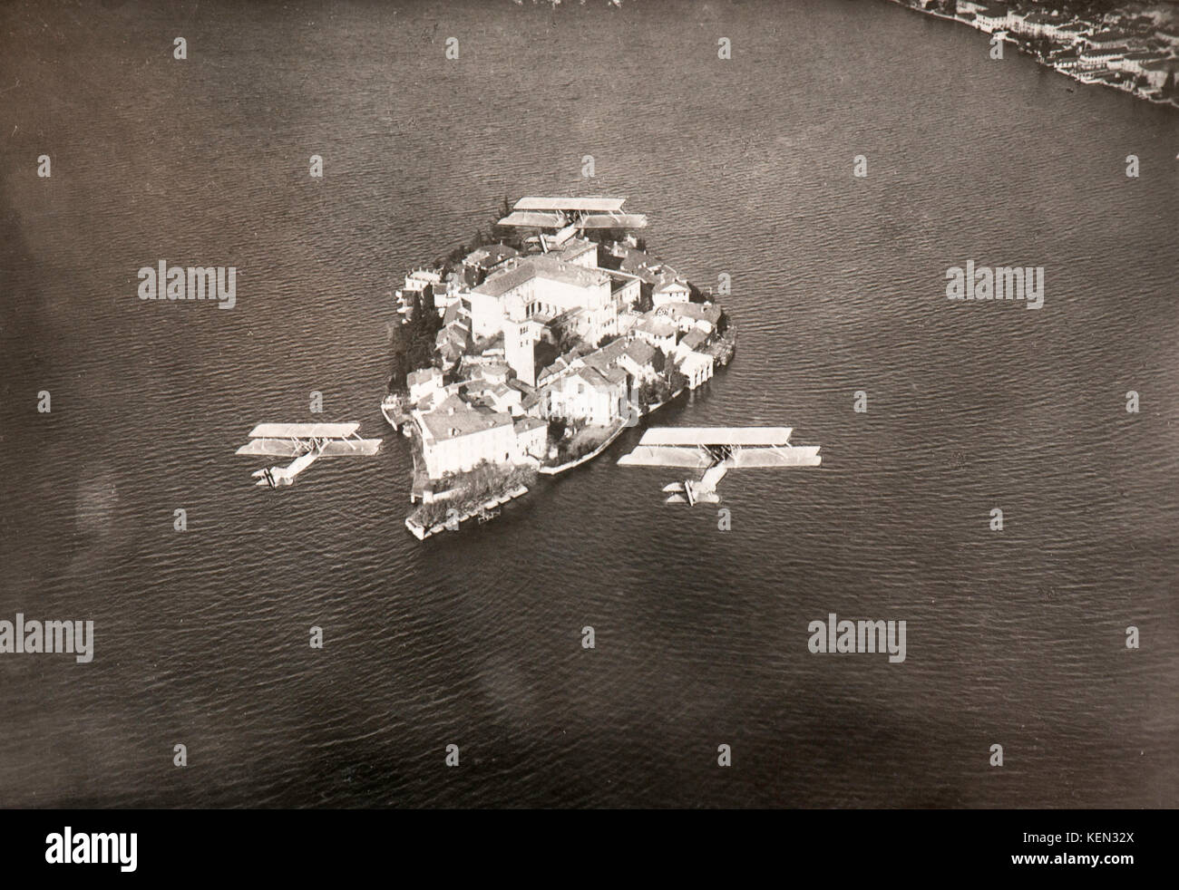 Formation of three bombers overflying Isola Bella, Lake Maggiore (Italy - 1930) - Stock Image