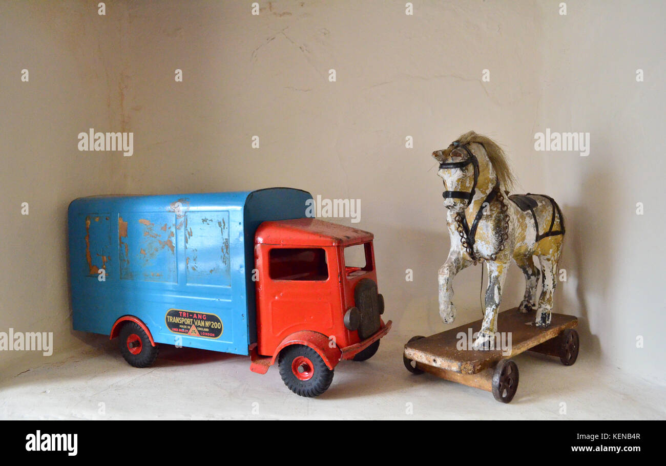 Old childrens toys on a shelf - Stock Image