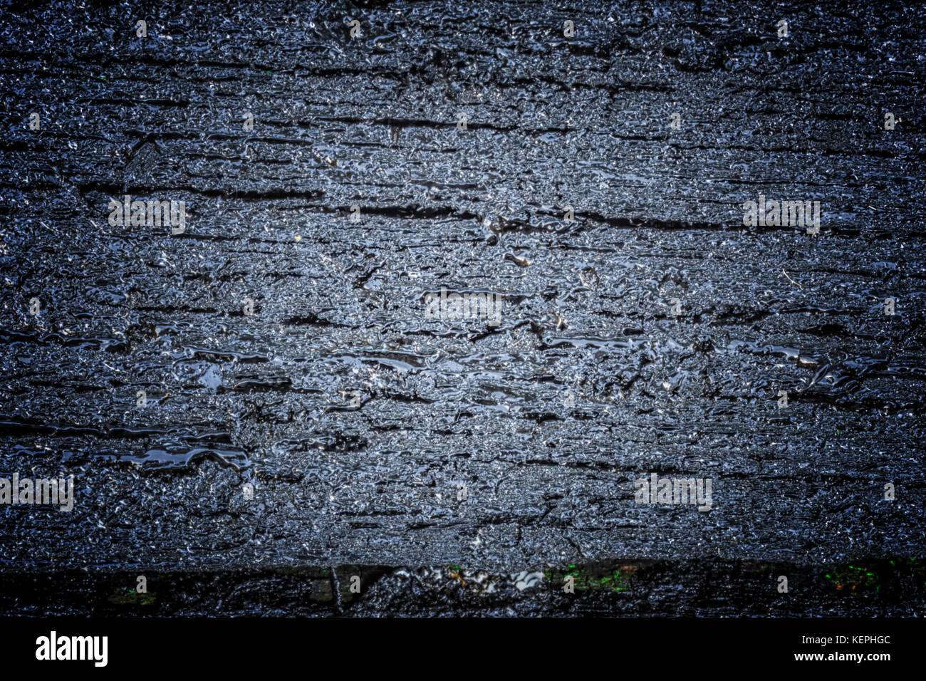 Black Rustic Wood Texture And Cracks On The Surface As Background