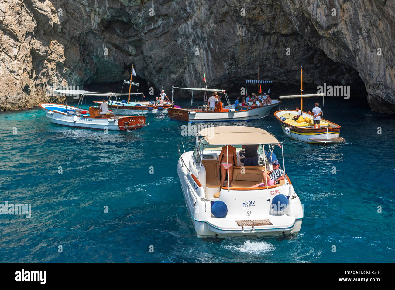 tourists on boat trips visit grotta verda on the island of capri, italy. Stock Photo