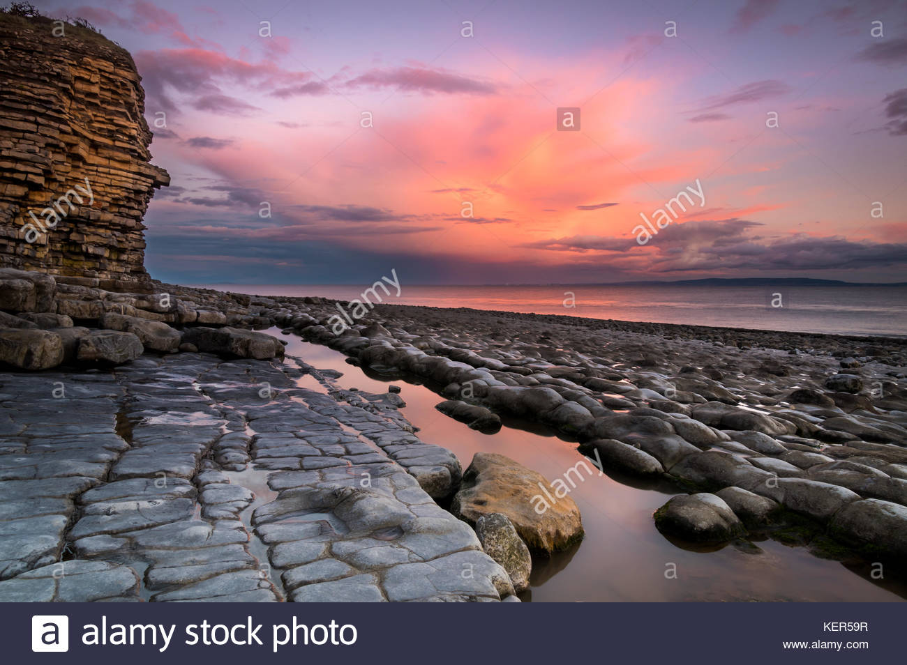 Stunning sunset seascape photograph taken at the heritage coast, Rhoose Point, Vale of Glamorgan in Wales. - Stock Image