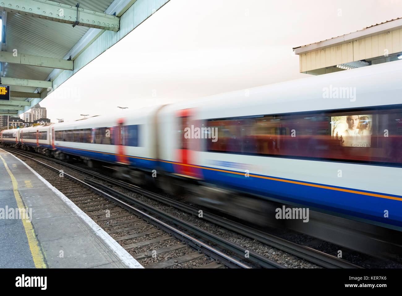 Speeding train passing through Vauxhall Station, Vauxhall, Greater London, England, United Kingdom - Stock Image