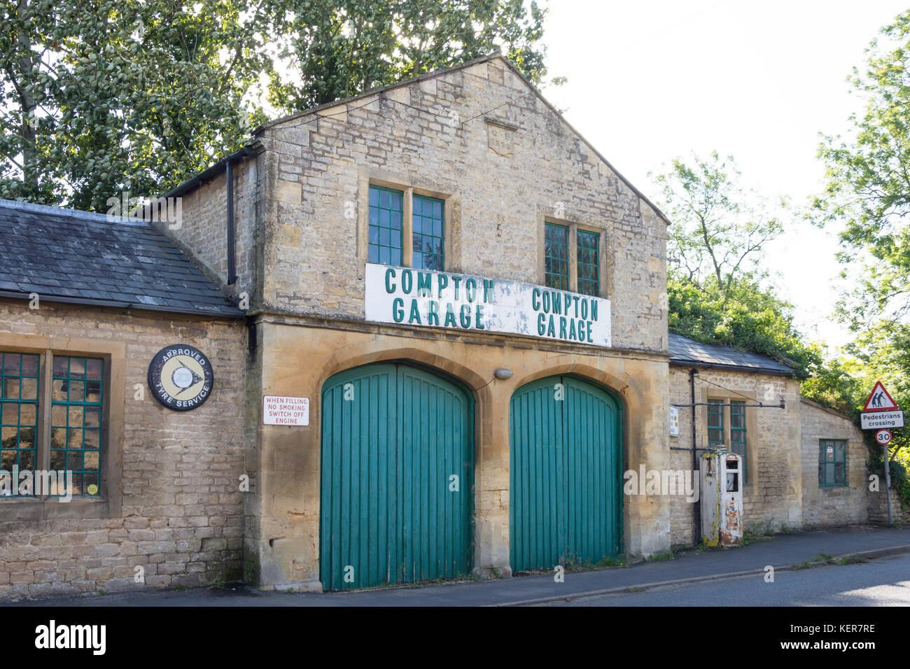 Old-fashioned garage frontage, Main Street, Long Compton, Warwickshire, England, United Kingdom - Stock Image