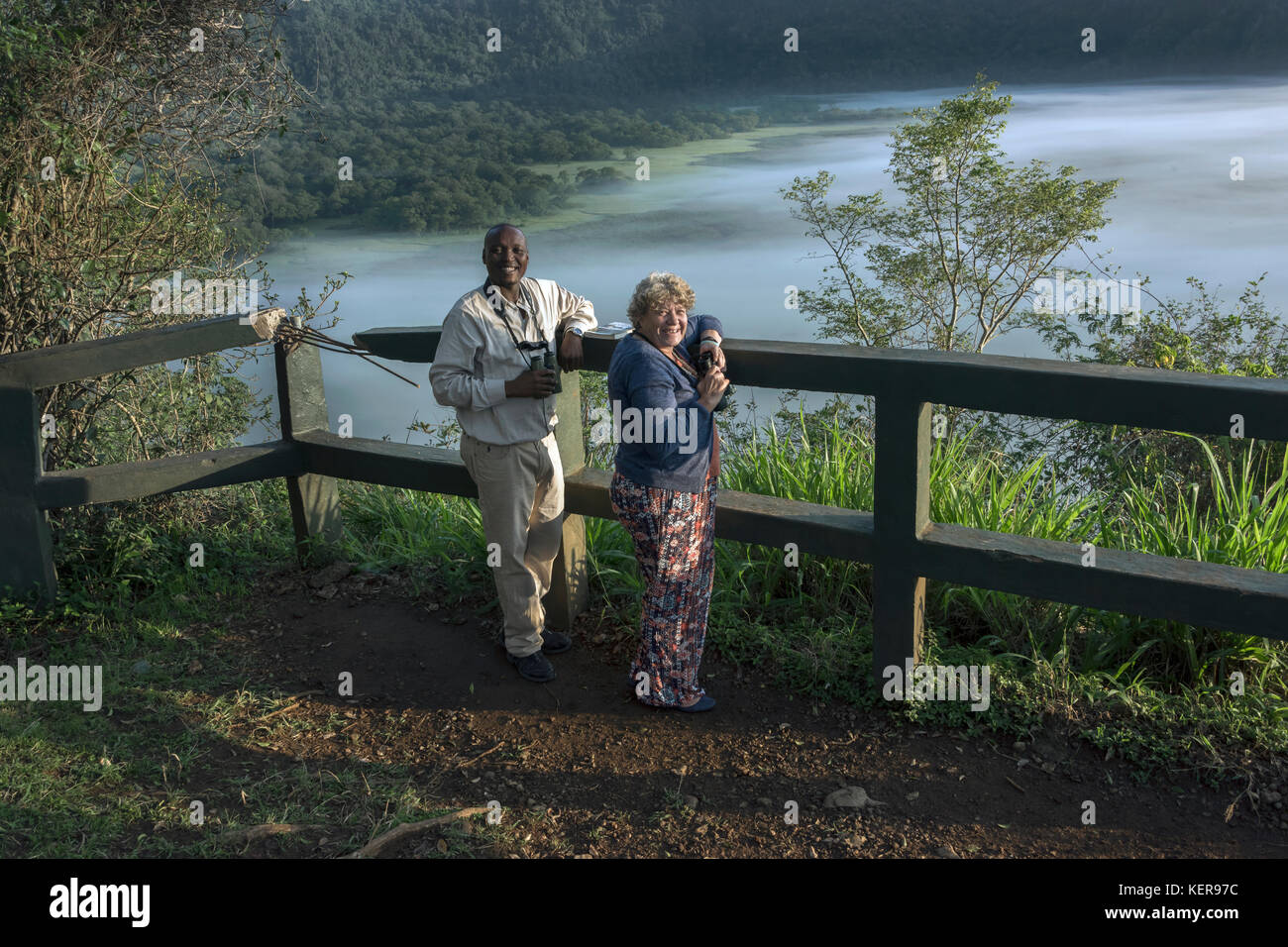 Smiling guide and client, Ngurdoto Crater, Arusha NP, Tanzania - Stock Image