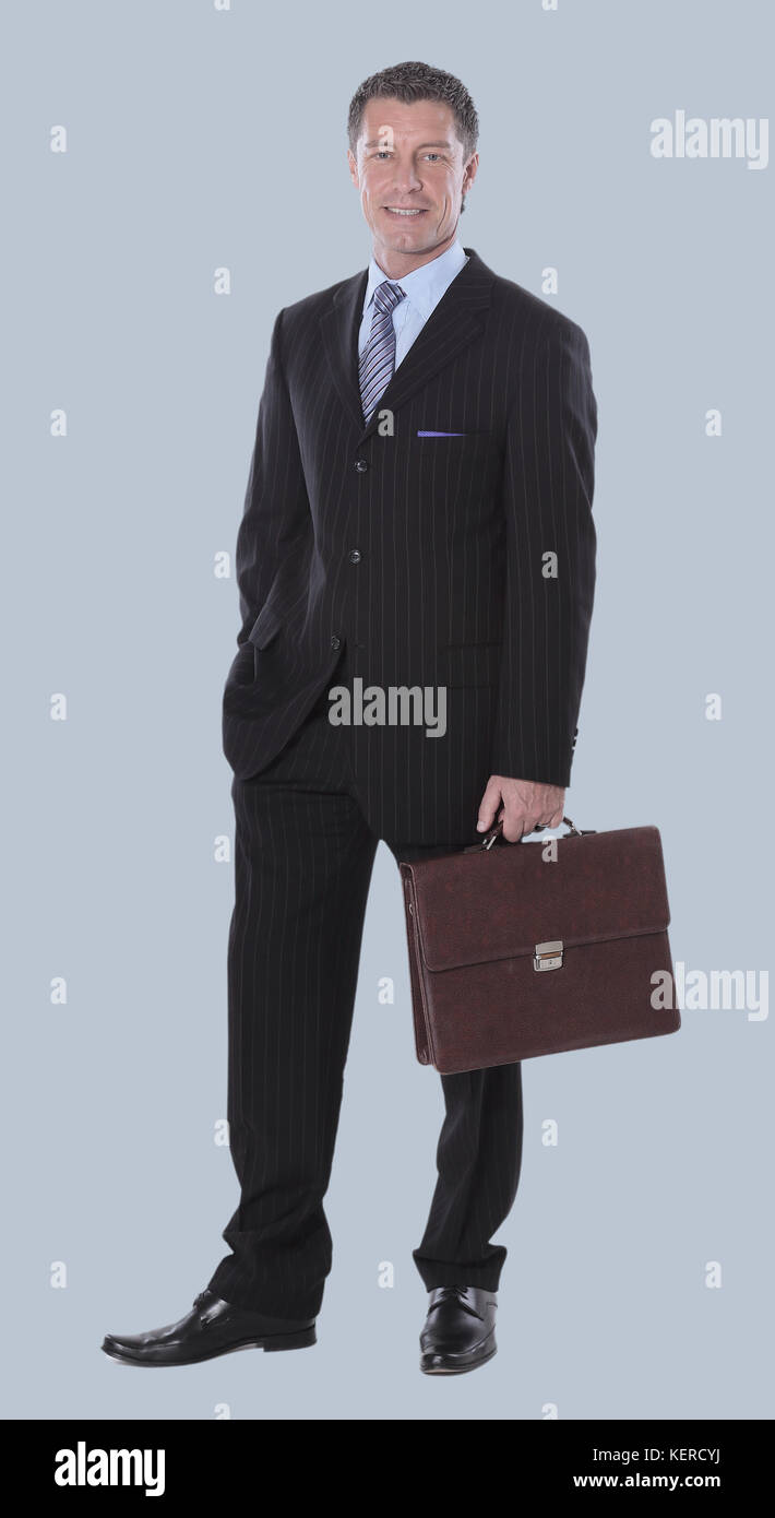 Business man with suitcase  isolated on gray background - Stock Image
