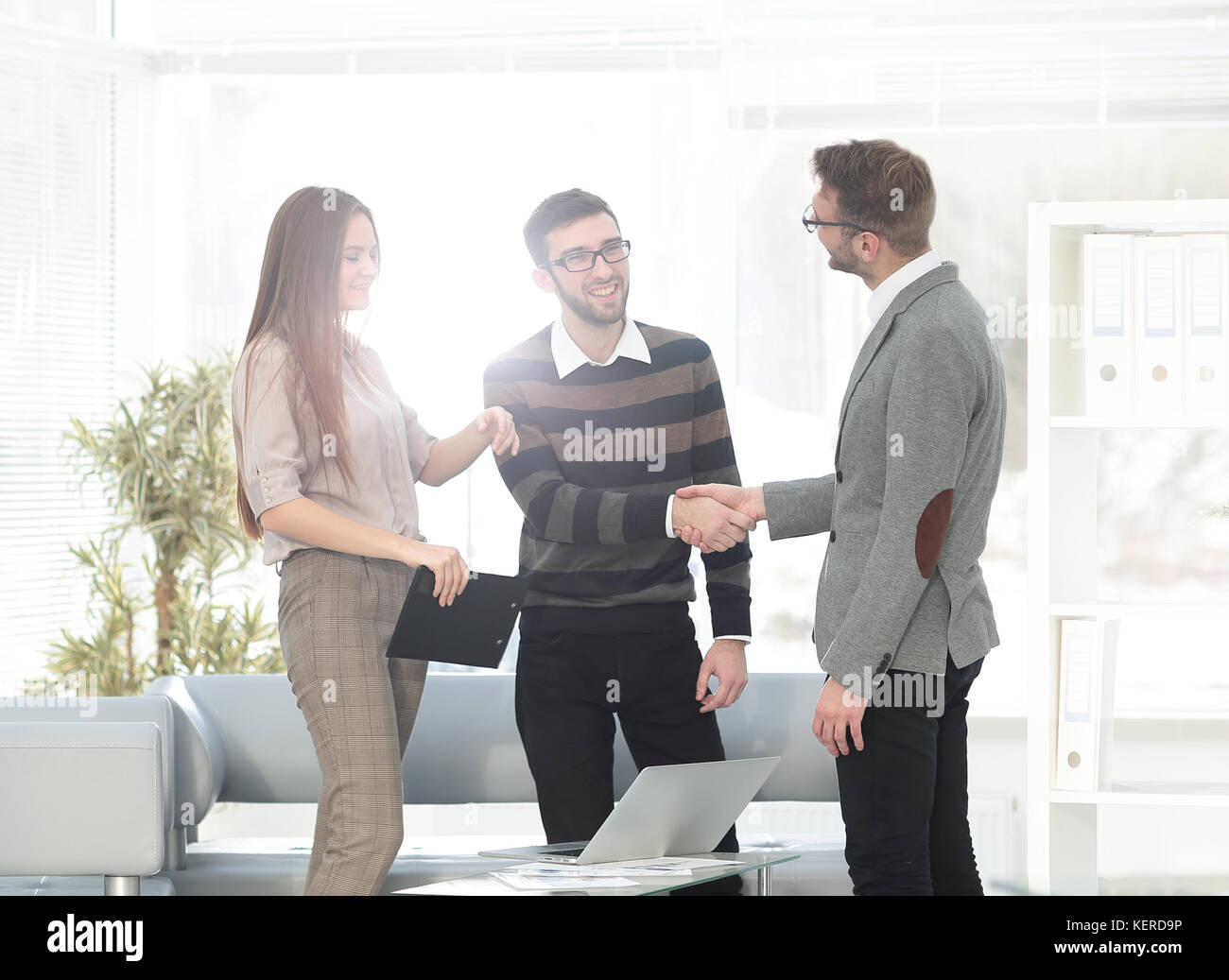 handshake Manager and employee in the office - Stock Image