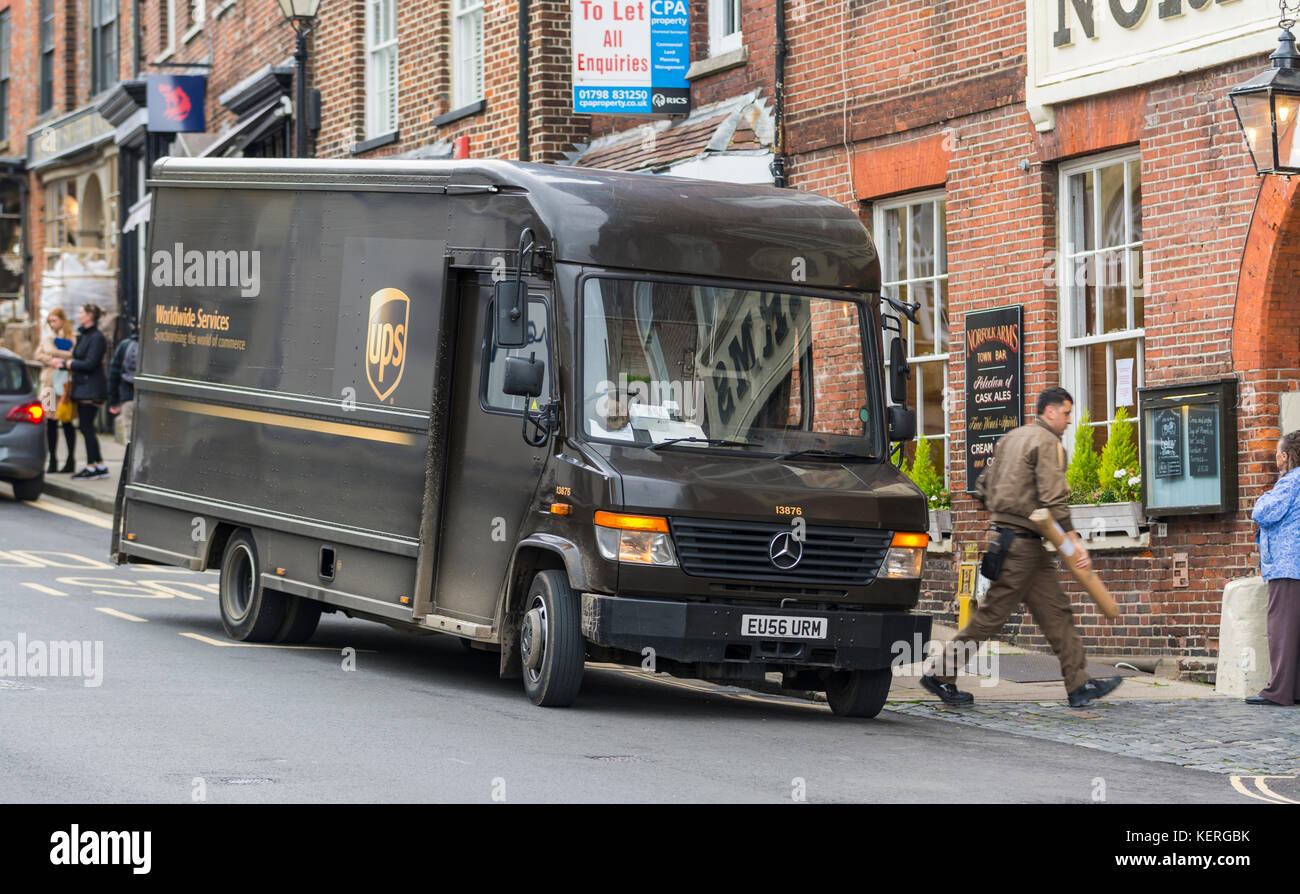 UPS van with delivery driver making a delivery in the UK. - Stock Image