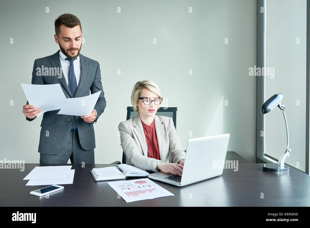 Teamwork at Open Plan Office - Stock Image