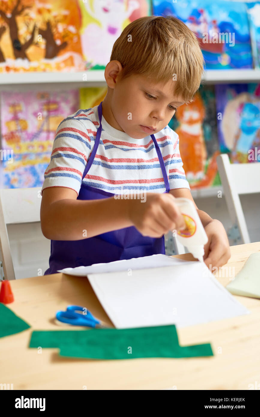 Little Boy Crafting in Class - Stock Image