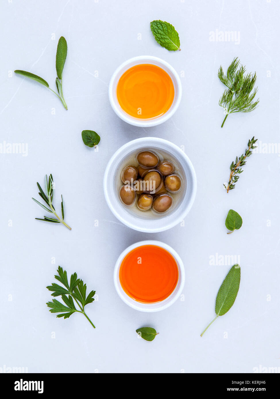 Different sorts of cooking oil,olive oil flavored and Sesame oil with spices  rosemary ,thyme,dill,sage mint and - Stock Image