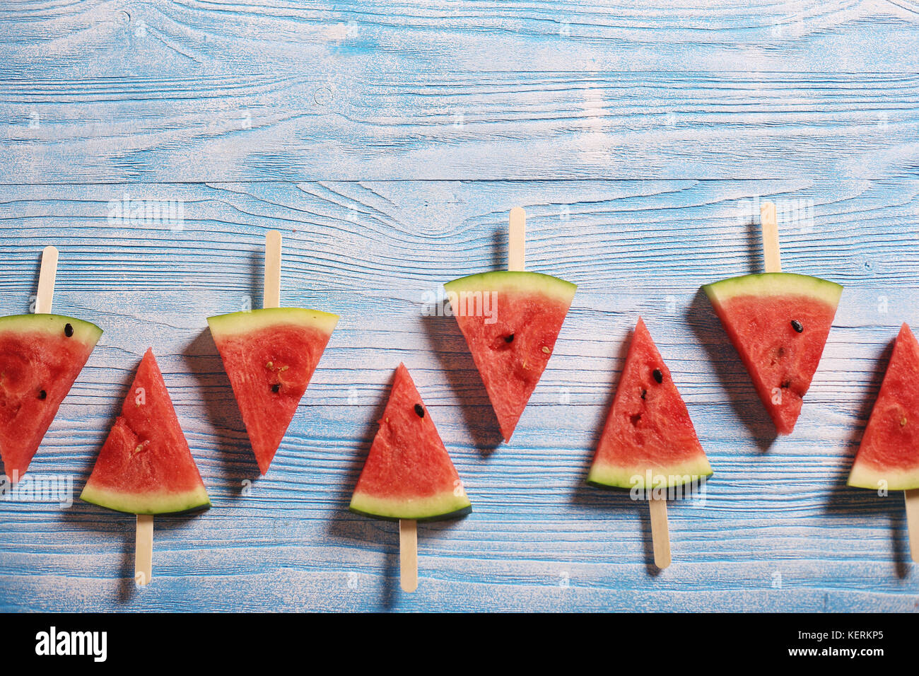 Slices of juicy red watermelon on a wooden background Stock Photo