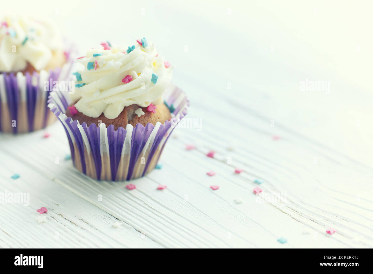 Festive cupcakes with burning candles - Stock Image