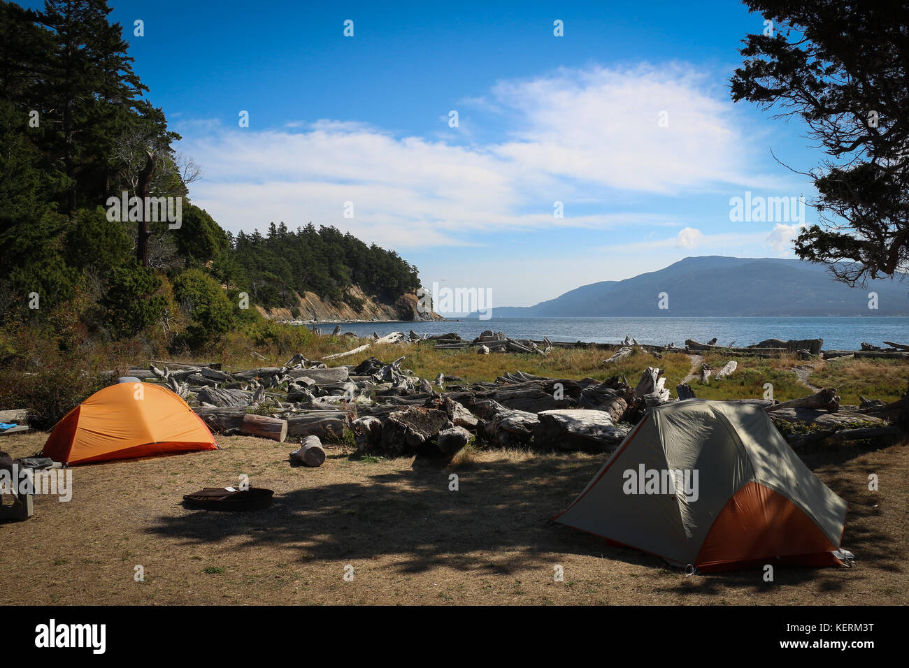Two tents, one orange,one gray, on a campsite on Sucia Isand, Washington State, overlooking Puget Sound, Orcas Island, - Stock Image