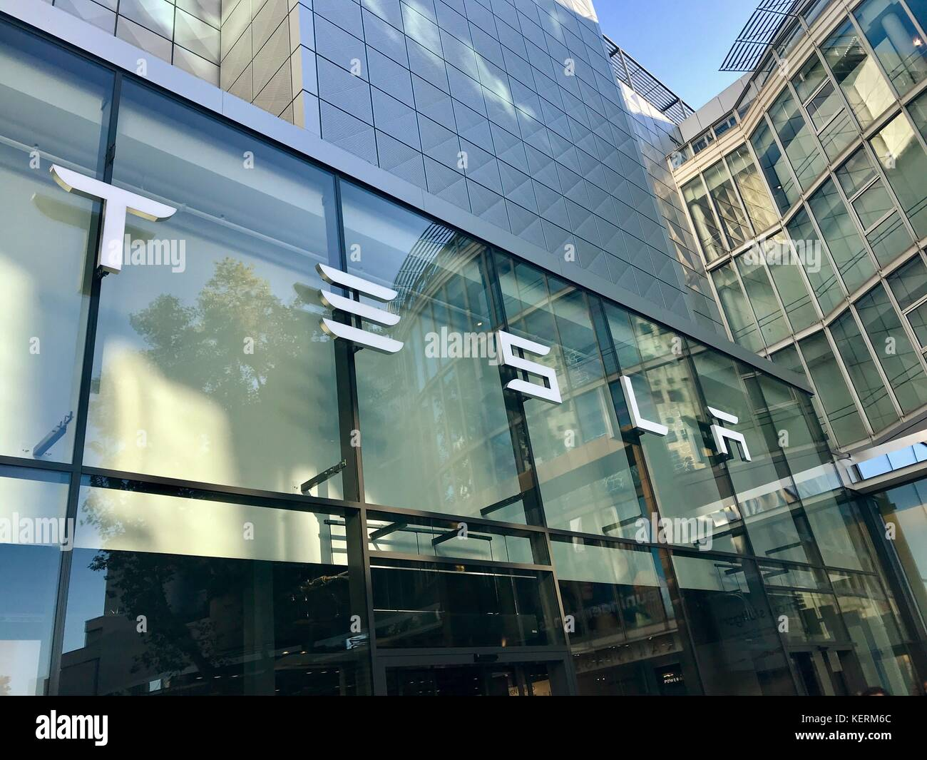 Tesla Motors logo on the showroom in Stuttgart, Germany - Stock Image