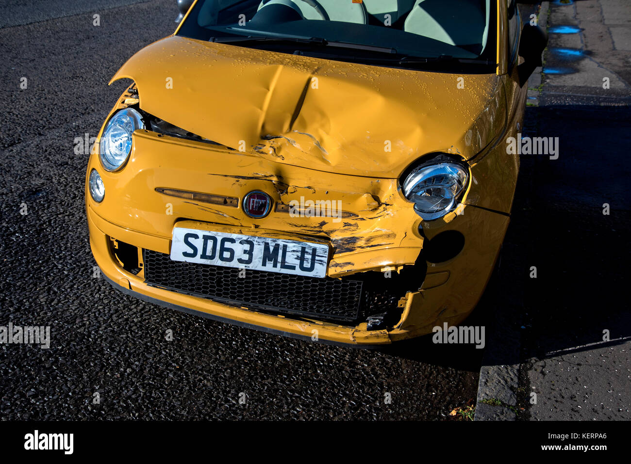 Yellow car damaged in a road traffic accident, in Edinburgh, Scotland, UK. Stock Photo