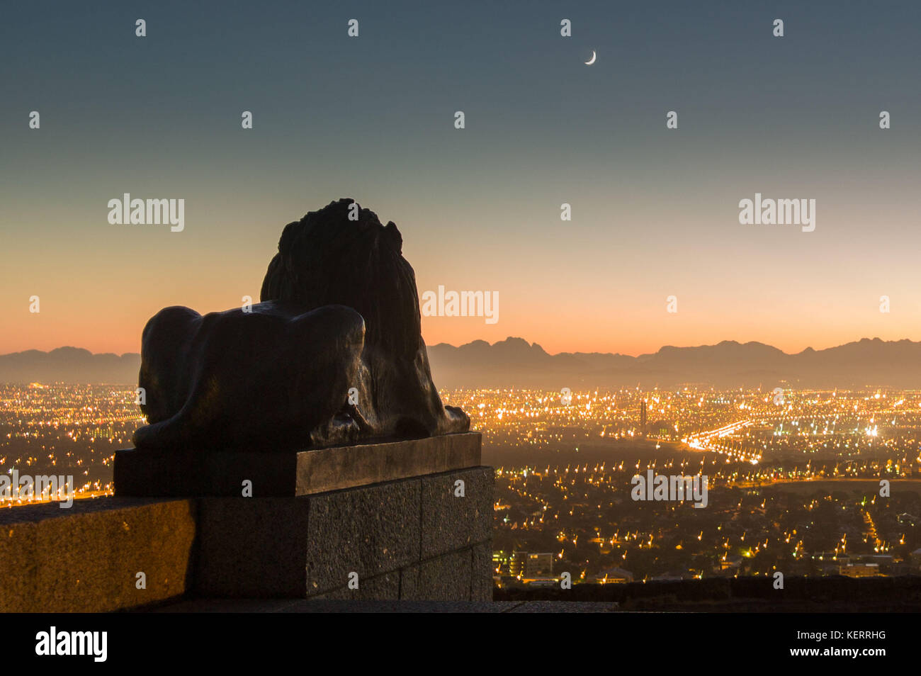 Rhodes Memorial overlooks the city lights and distant mountain ranges of the City of Cape Town, Western Cape, South Stock Photo