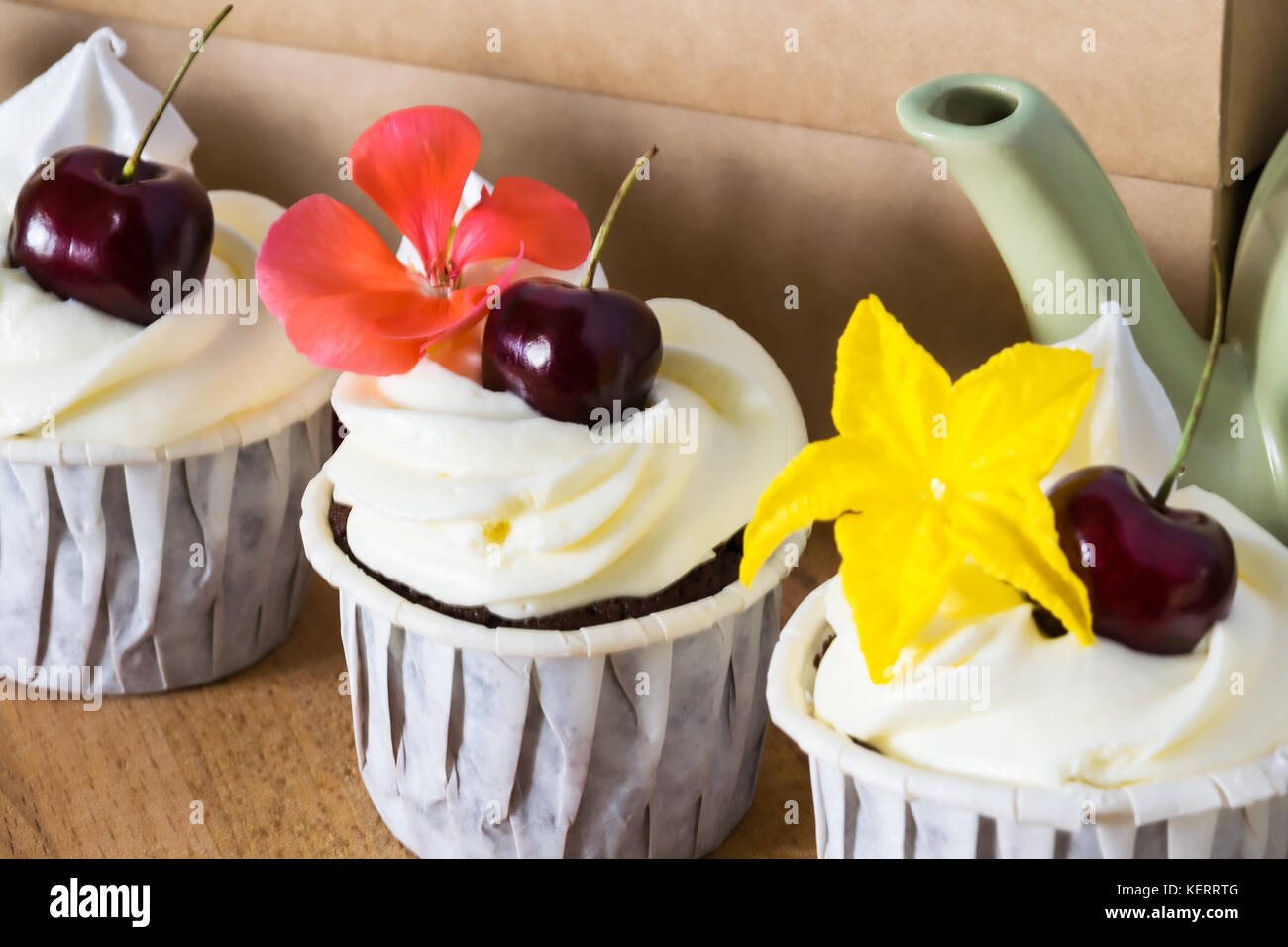 Three Beautiful Cakes With Cherries And Flowers On A Teapot Stock
