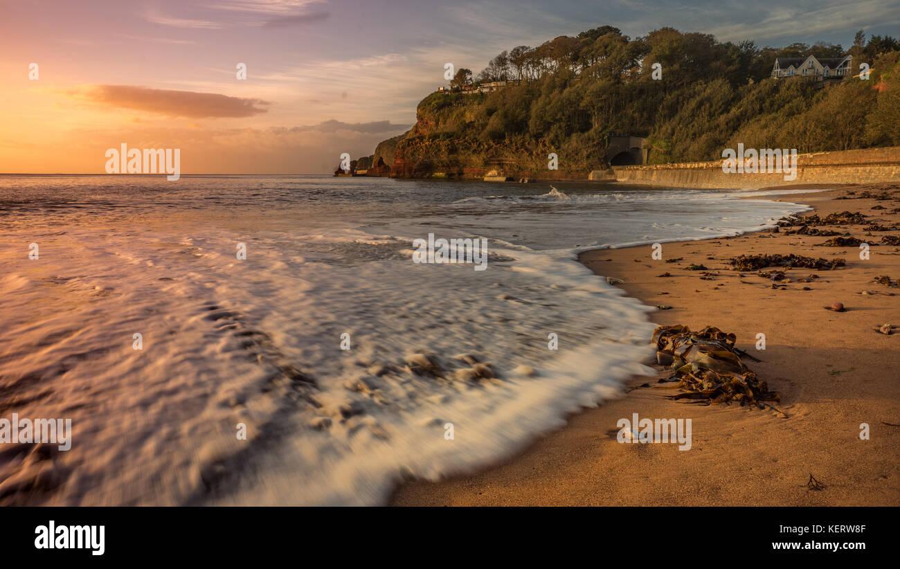 Dawlish Beach in the early morning sun - Stock Image