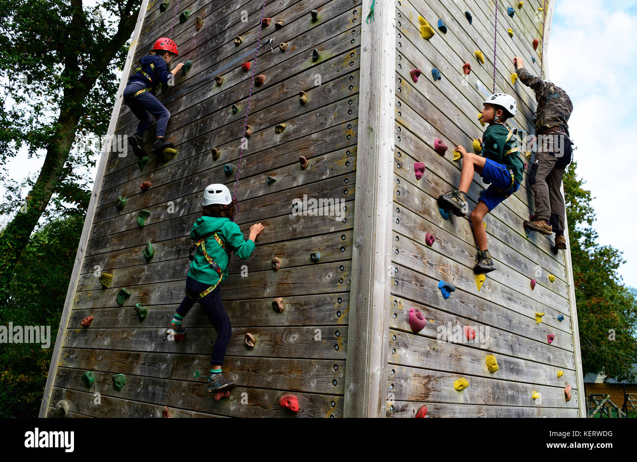 Youngsters and adult using climbing wall to help raise money for a new scout building, Tilford, near Farnham, Surrey, - Stock Image