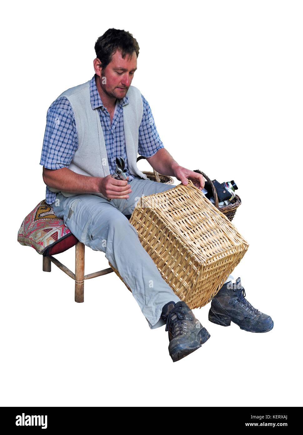Man basket weaving at craft stand - Stock Image
