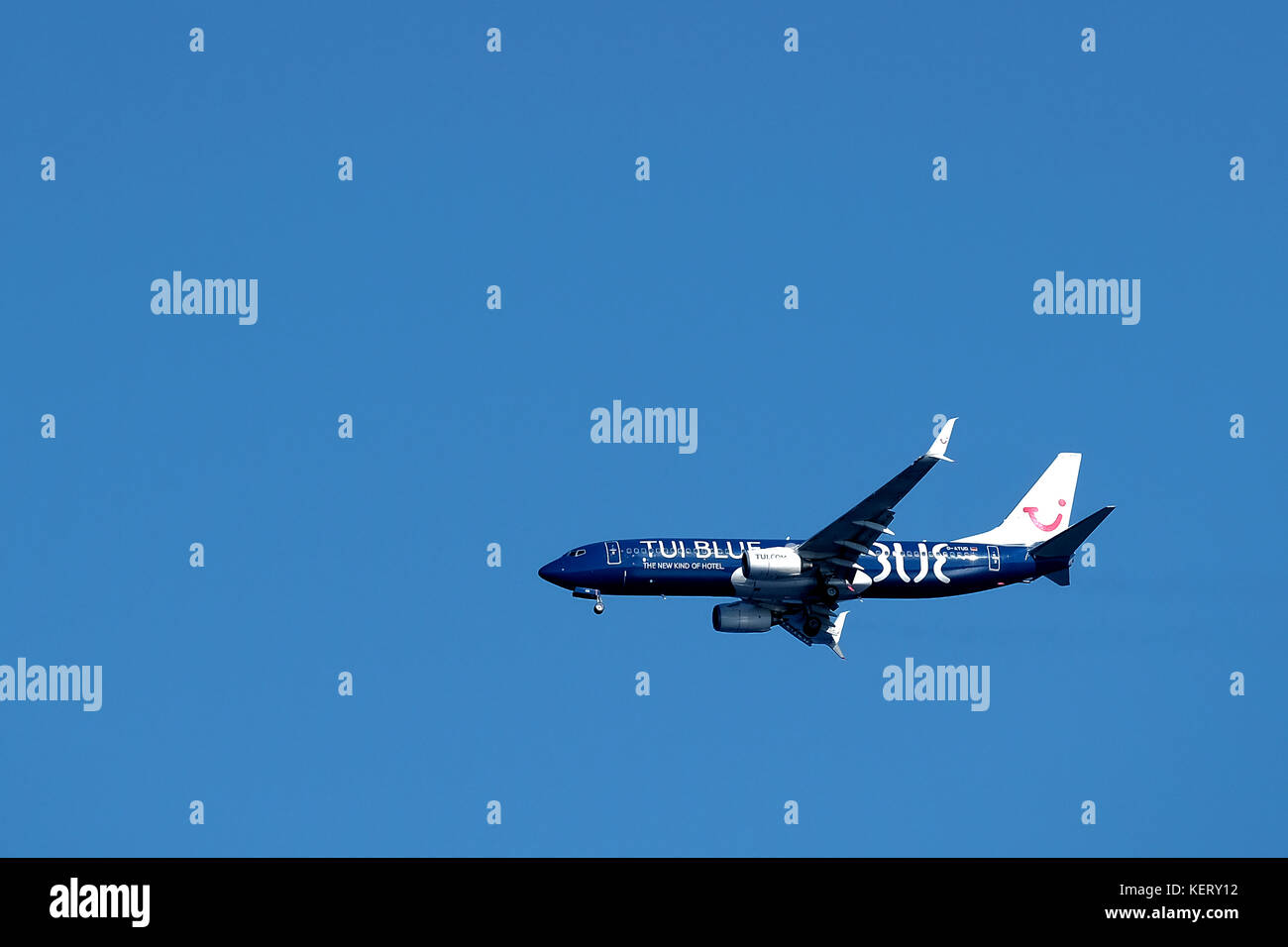A TUI Blue aircraft, in the air, preparing to land, with its undercarriage down, at Rhodes airport - Stock Image