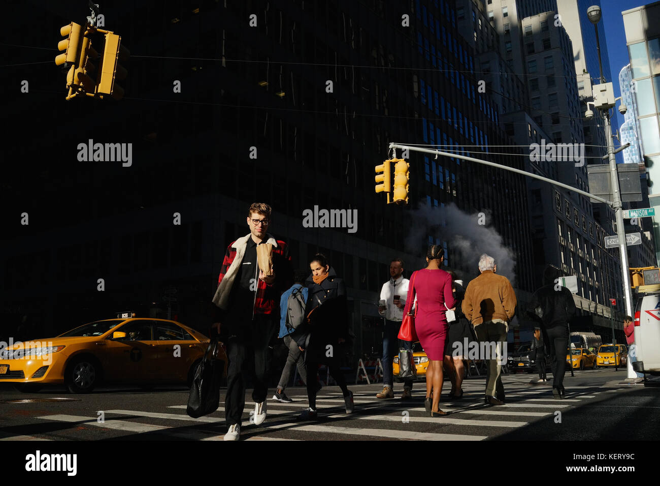 People at a pedestrian crossing in New York City midtown - Stock Image