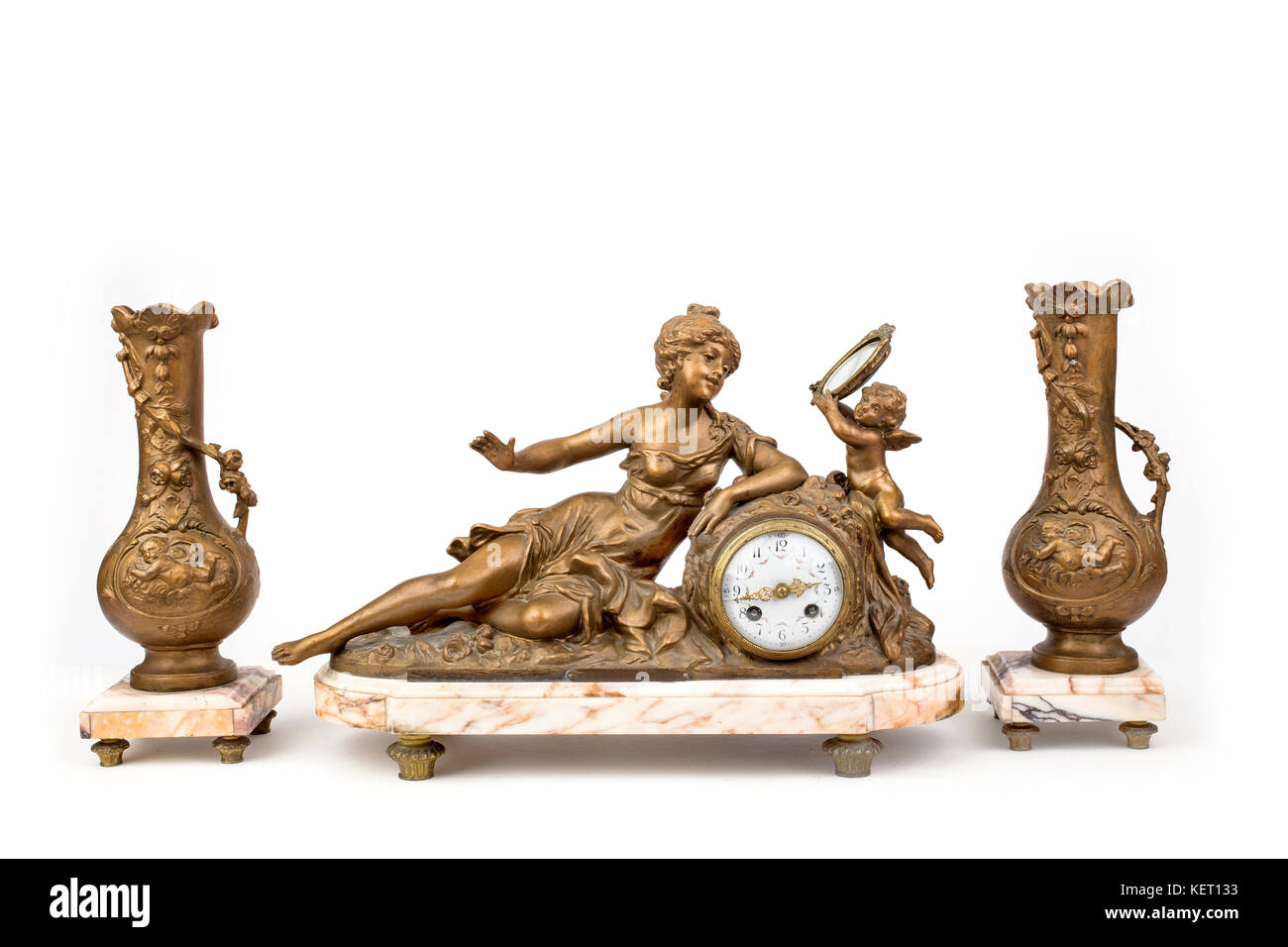 Interior mantel set from clock 'coquetry' and pair of  decorative vases. - Stock Image