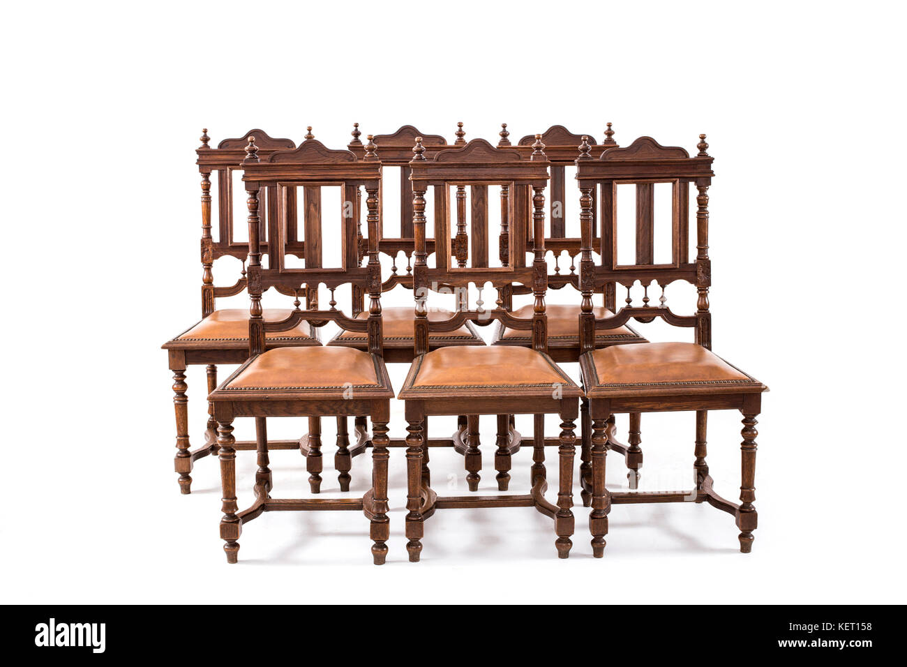 Set Of Old Fashioned Wood Chairs On The White Background.   Stock Image