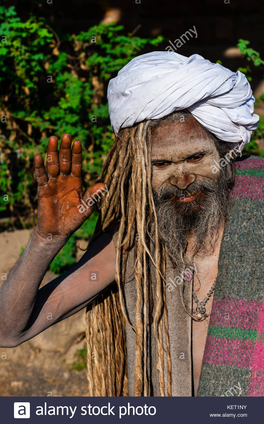 A sadhu walking along a road in Agra, Uttar Pradesh, India. Stock Photo