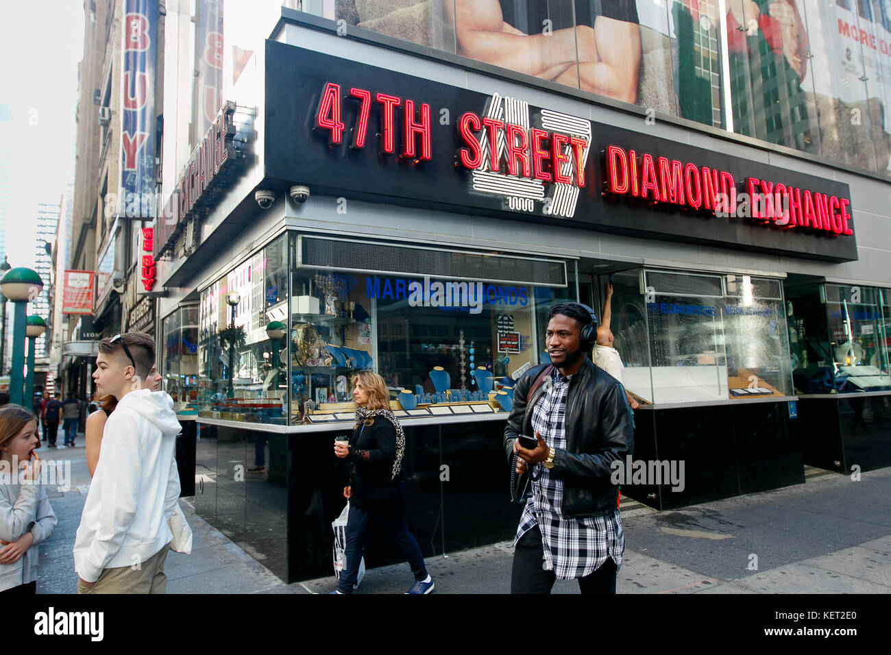 People walk by 47th Street Diamond Exchange at the 6th Avenue end of the diamond district of NYC. Stock Photo
