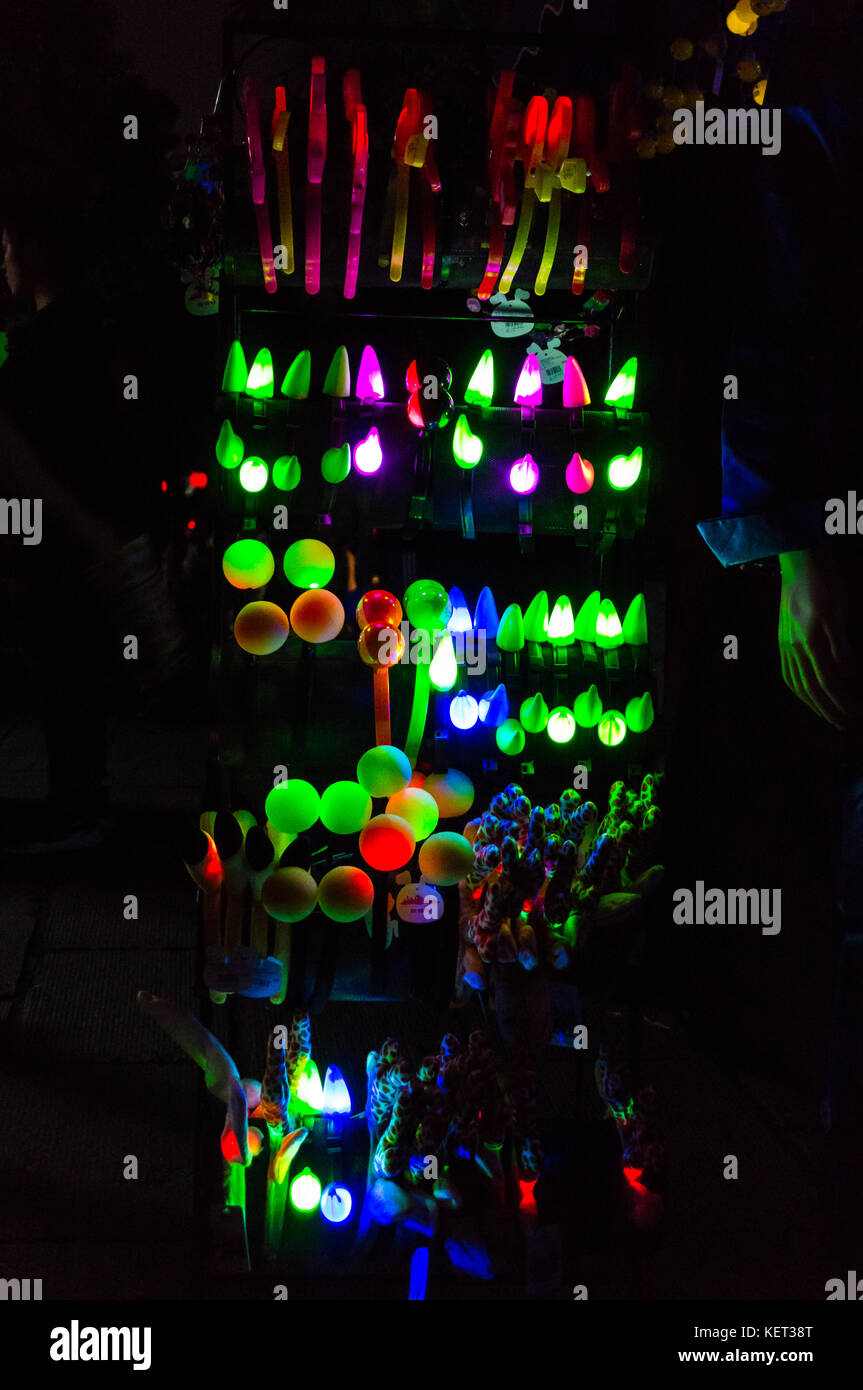 Glowing Halloween headgear for sale at night at a Halloween event in Shenzhen, China - Stock Image
