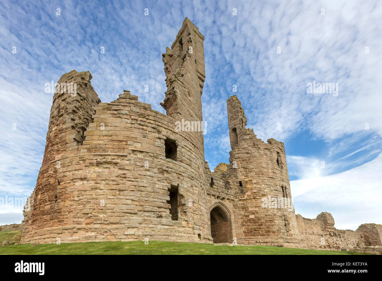 Dunstanburgh Castle on the Northumbrian coast, England, UK - Stock Image