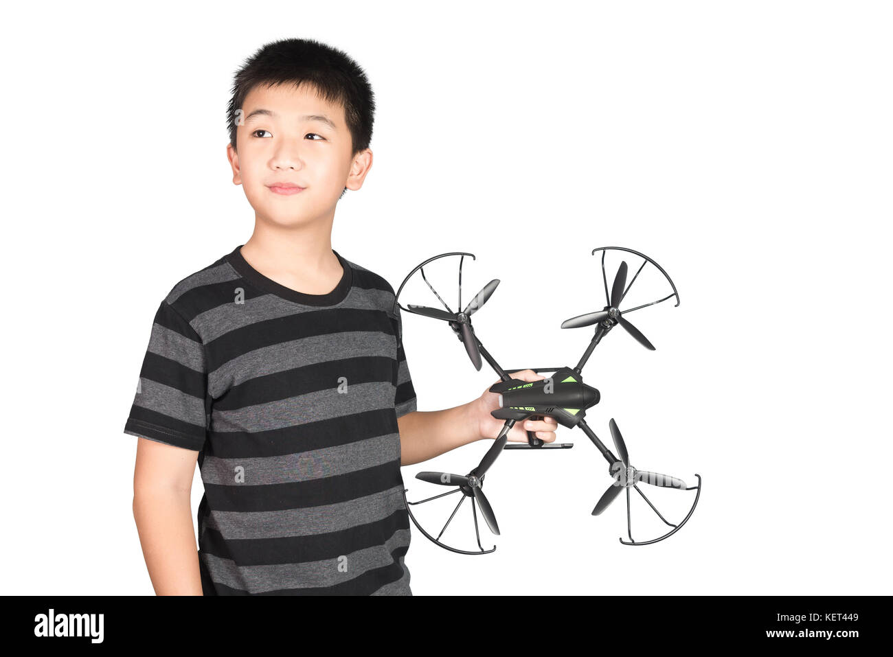 Asian boy holding hexacopter drone or quadrocopter toy in hand, studio shot isolated on white background. - Stock Image