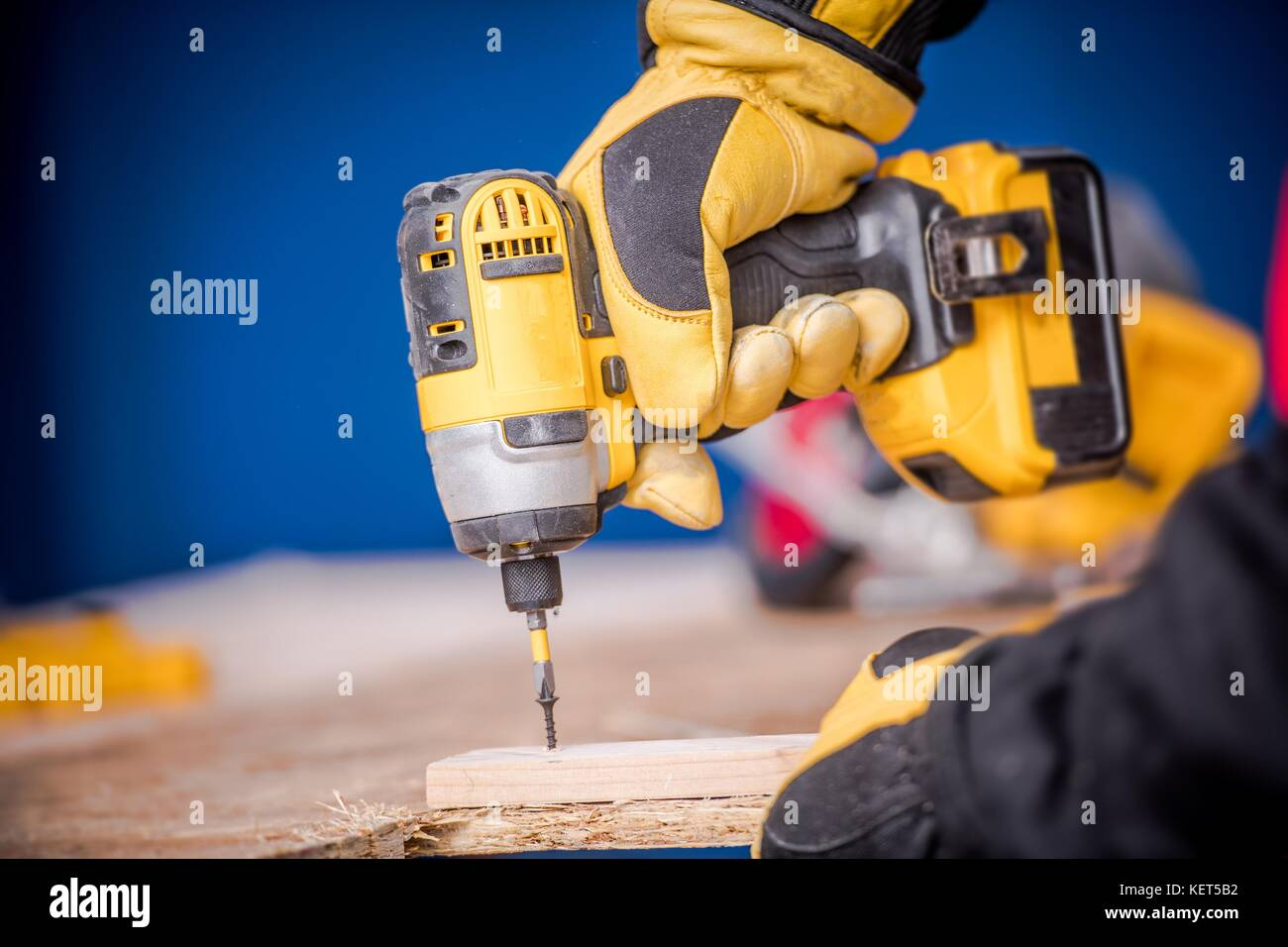 Small Construction Works  Contractor Worker with Cordless Drill