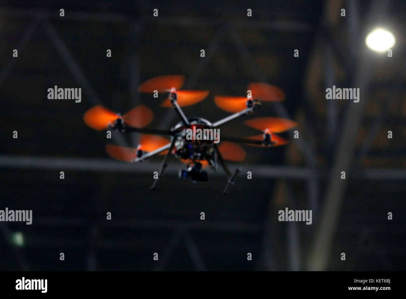 blurry flying drone with camera on the night - Stock Image