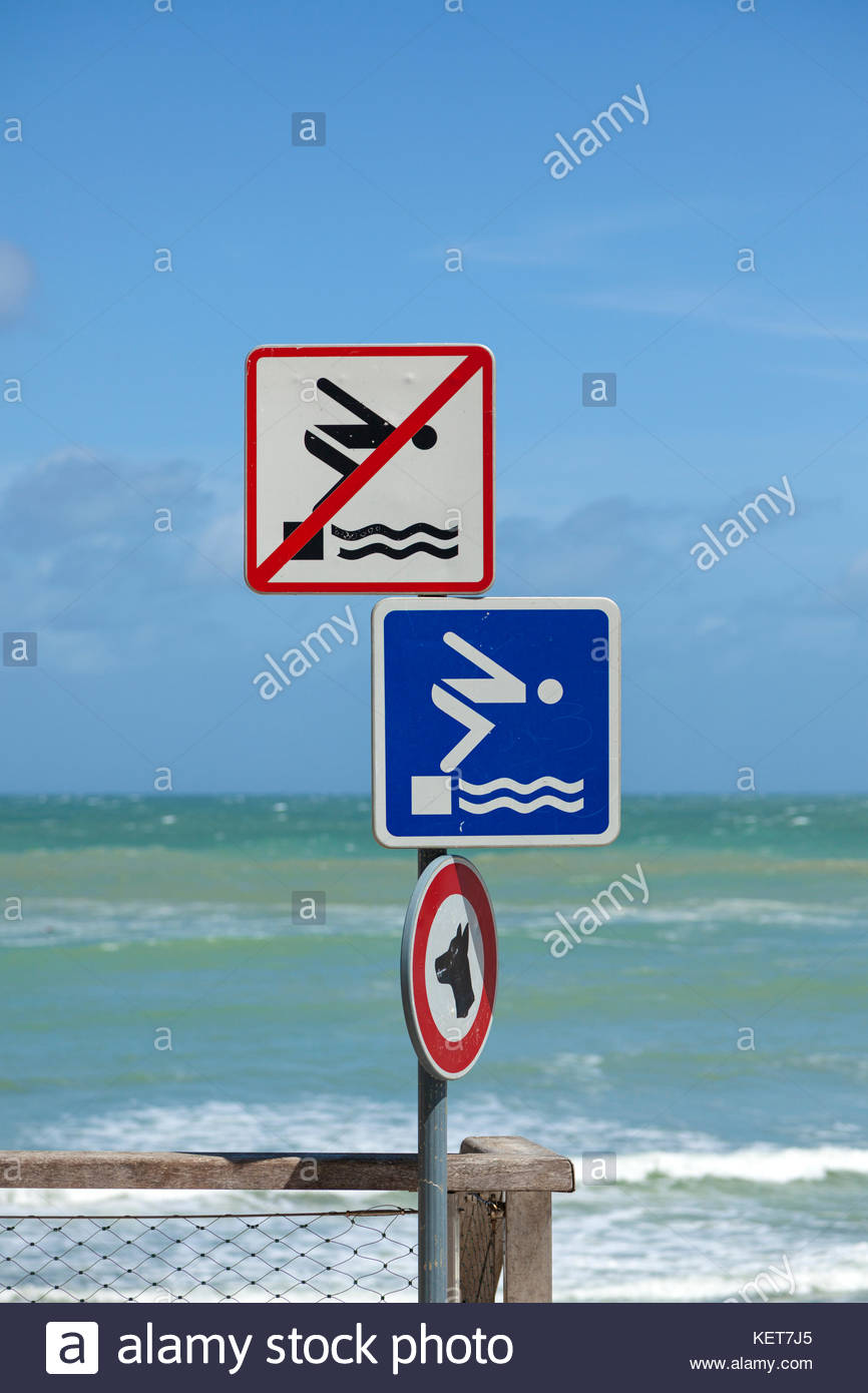 Swimming permitted and swimming prohibited signs at French beach - Stock Image