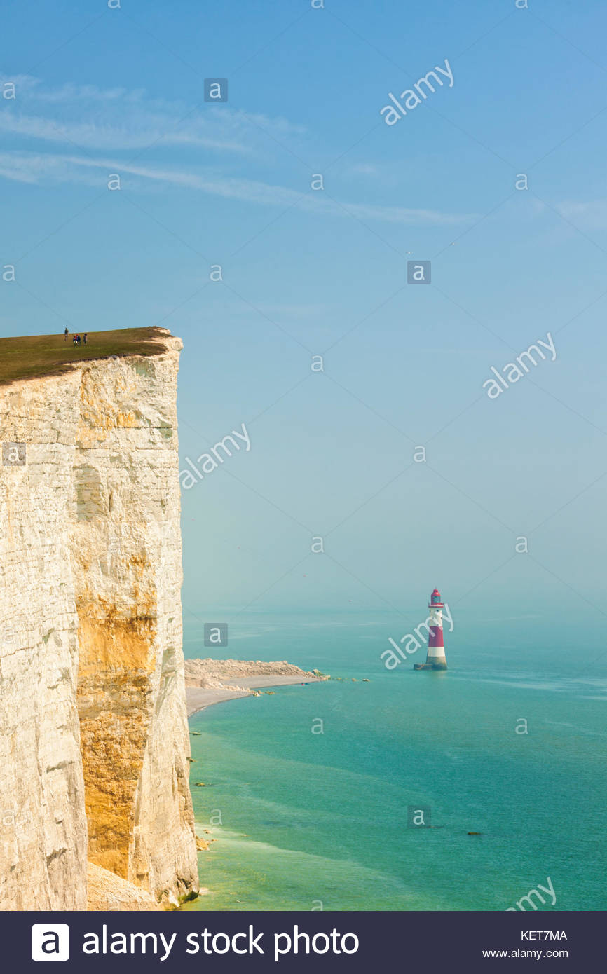 Cliff at Beachy Head, East Sussex, and lighthouse in haze - Stock Image