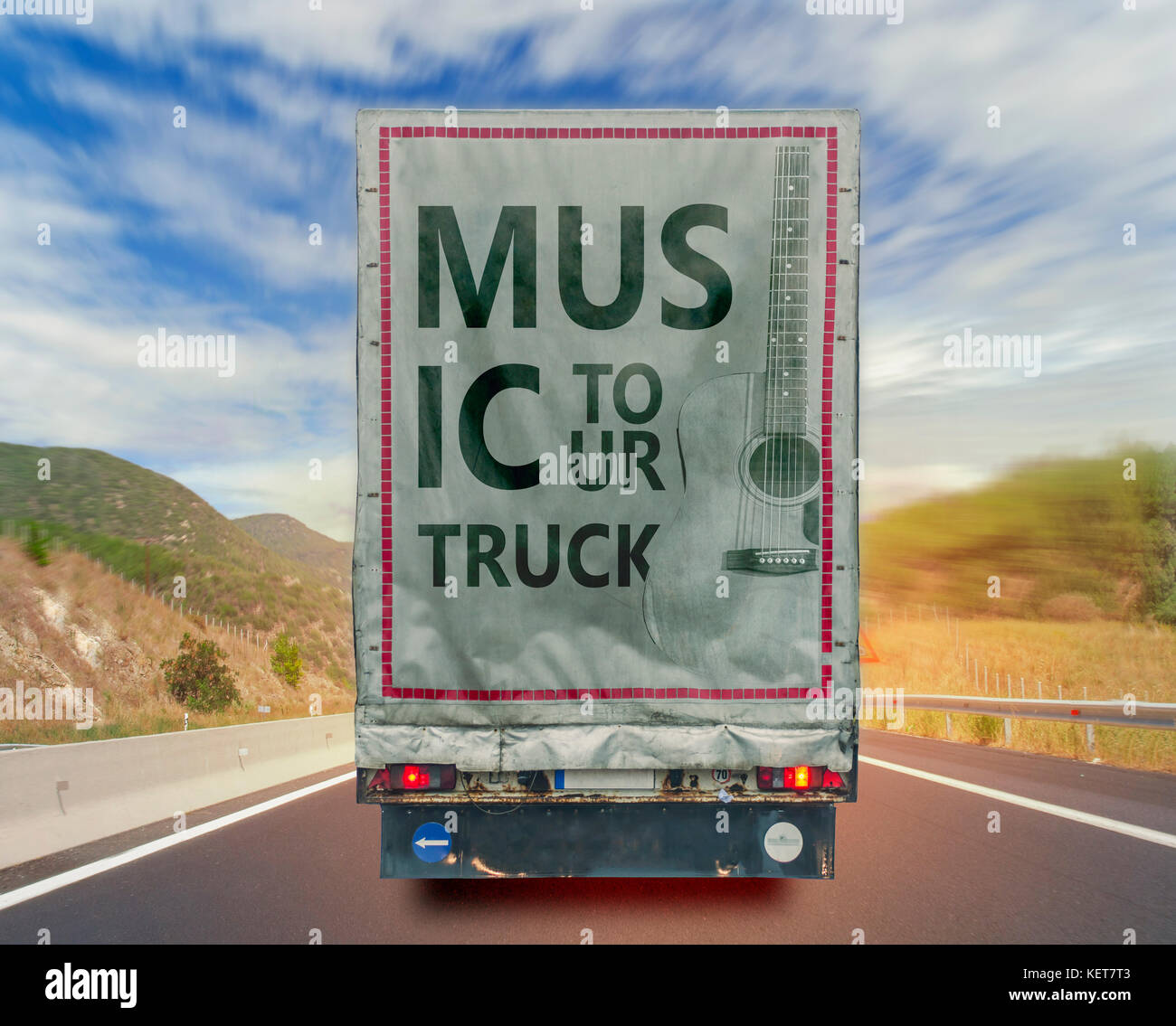 Back view of music tour truck cargo transport container on the high way road - Stock Image
