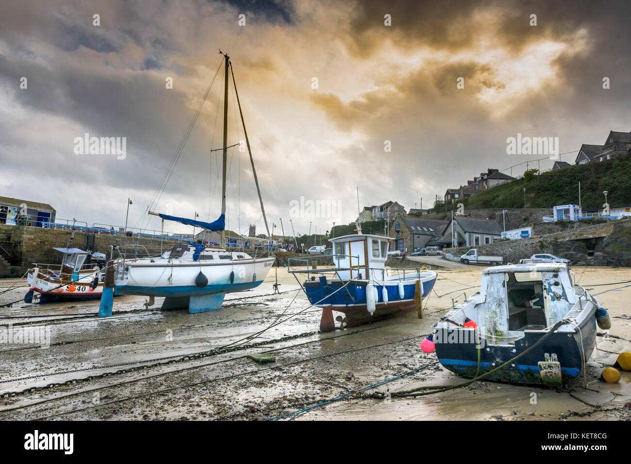 Newquay Harbour Cornwall - evening light over boats tied up at low tide in Newquay harbour. - Stock Image