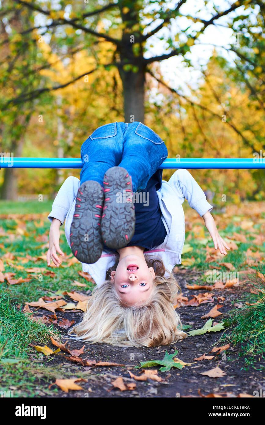 Child Hanging Upside Down On Climbing Stock Photos & Child ...